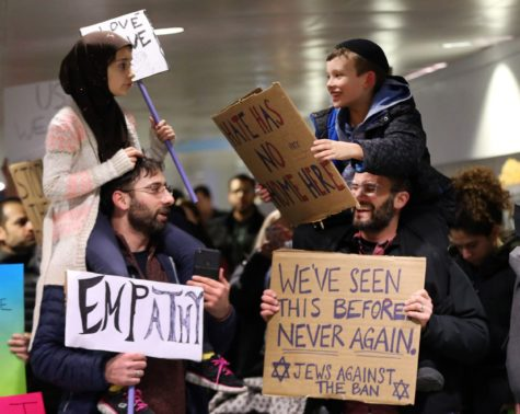 This Touching Picture at a Travel Ban Protest has Warmed the Hearts of Many Americans