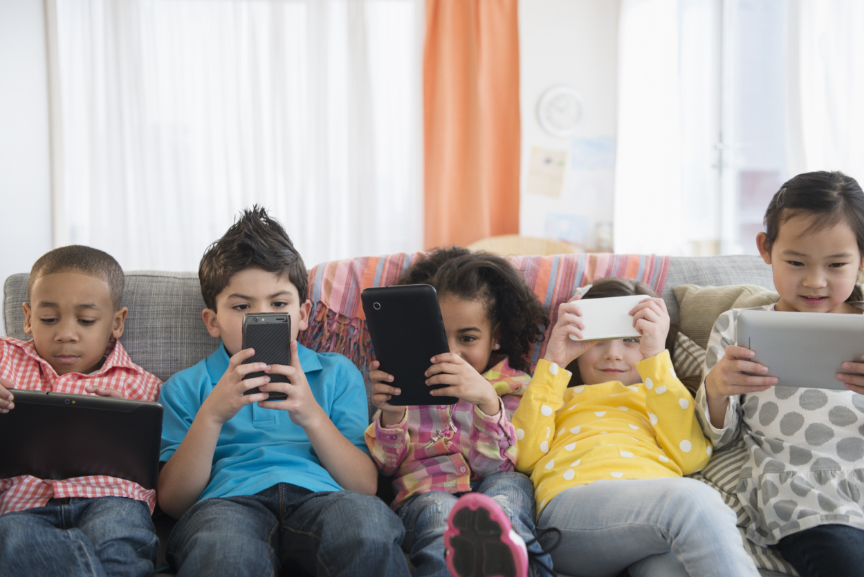 Children+using+technology+on+sofa