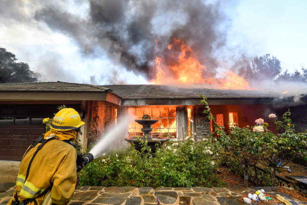 Fire+fighters+work+to+extinguish+a+fire+on+Via+El+Estribo+during+the+Canyon+Two+Fire+in+Anaheim%2C+California%2C+on+Monday%2C+October+9%2C+2017.+%0A%0A%28Photo+by+Jeff+Gritchen%2C+Orange+County+Register%2FSCNG%29
