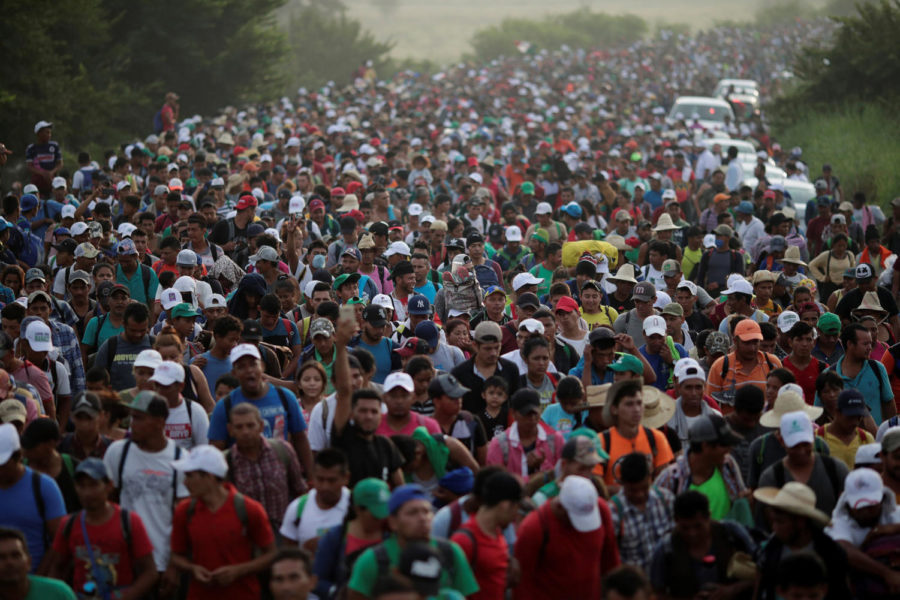 A+caravan+of+thousands+of+migrants+from+Central+America%2C+en+route+to+the+United+States%2C+makes+its+way+to+San+Pedro+Tapanatepec+from+Arriaga%2C+Mexico+on+Oct.+27%2C+2018.