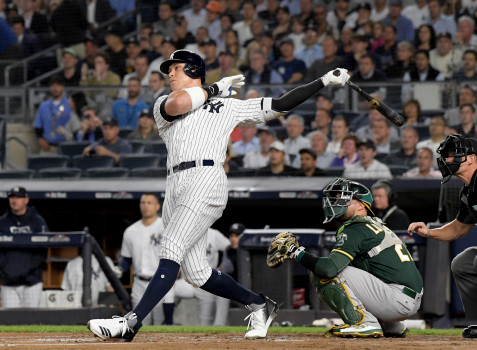 New York Yankees' Aaron Judge follows through on a two-run home run against the Oakland Athletics during the first inning of the American League wildcard playoff baseball game, Wednesday, Oct. 3, 2018, in new York (AP Photo/Bill Kostroun)