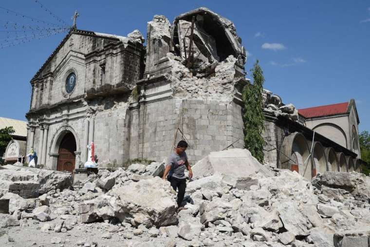 https://www.catholicnewsagency.com/images/St_Catherine_of_Alexandria_church_in_Porac_was_damaged_when_an_April_23_earthquake_struck_the_Philippines_Credit_Ted_Aljibe__AFP__Getty_Images.jpg?w=760