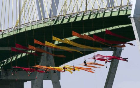 Greenpeace activists suspend themselves from Houston bridge to protest fossil fuels