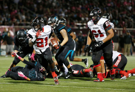 Corona Centennial running back JJ Taylor (21) breaks away for a touchdown in the first half against Corona Santiago during the Big VIII League, CIF Southern Section football game, Friday, Oct. 24, 2014 in Corona, Calif. (Press-Enterprise/Doug Benc)