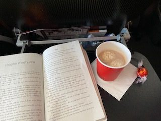 The above image is a picture I took of my hot chocolate and Lindt chocolate while on the flight.